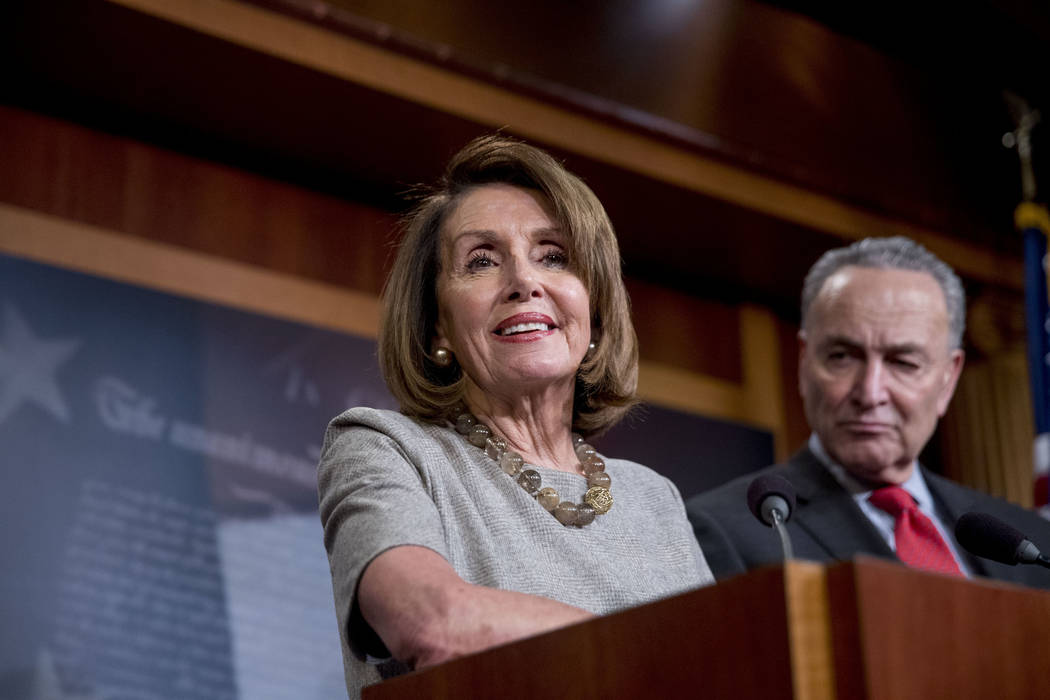 Speaker Nancy Pelosi of Calif., accompanied by Senate Minority Leader Sen. Chuck Schumer of N.Y., right, speaks during a news conference on Capitol Hill in Washington, Friday, Jan. 25, 2019, after ...