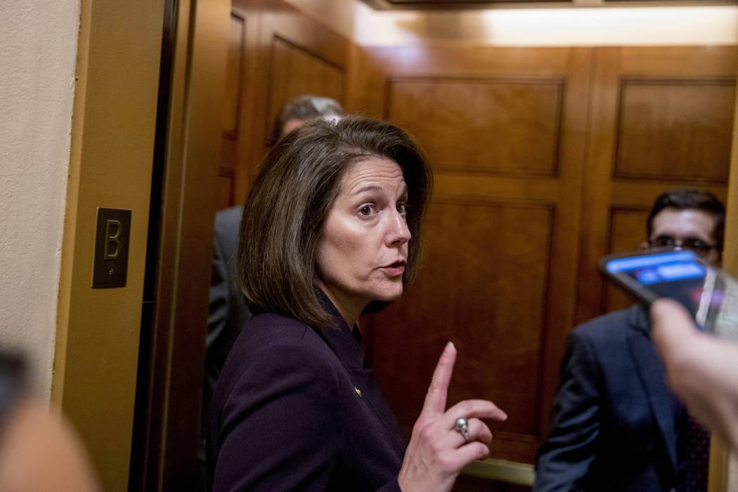Sen. Catherine Cortez Masto, D-N.V., speaks to a reporter as she arrives on Capitol Hill in Washington, Thursday, Jan. 24, 2019. (AP Photo/Andrew Harnik)
