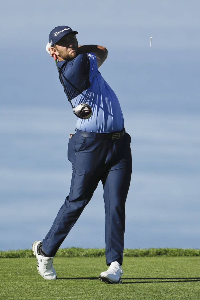 Jon Rahm, of Spain, watches his tee shot on the 11th hole during the first round of the Farmer's Insurance Open golf tournament on the North Course at Torrey Pines Golf Course on Thursday, Jan. 24 ...