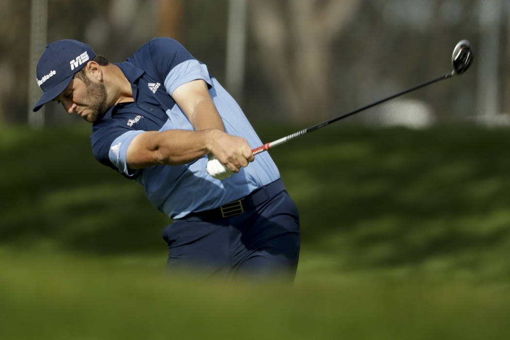 Jon Rahm, of Spain, hits from the fairway on the ninth hole during the first round of the Farmers Insurance Open golf tournament on the North Course at Torrey Pines Golf Course on Thursday, Jan. 2 ...