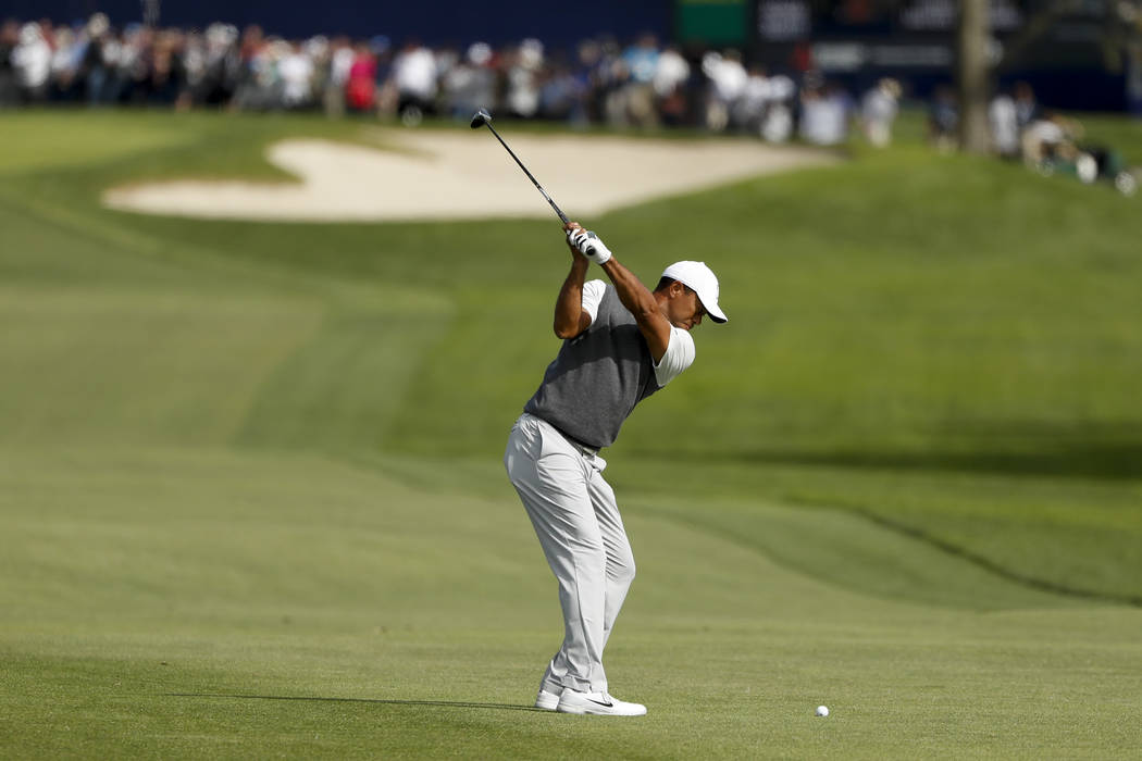 Tiger Woods hits his second shot on the sixth hole of the South Course at Torrey Pines during the first round of the Farmers Insurance golf tournament Thursday, Jan. 24, 2019, in San Diego. (AP Ph ...