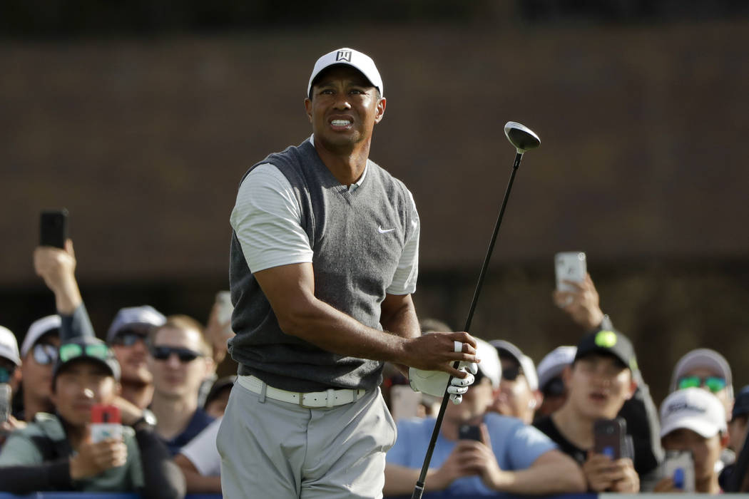 Tiger Woods watches his tee shot on the 14th hole of the South Course at Torrey Pines Golf Course during the first round of the Farmers Insurance golf tournament Thursday, Jan. 24, 2019, in San Di ...