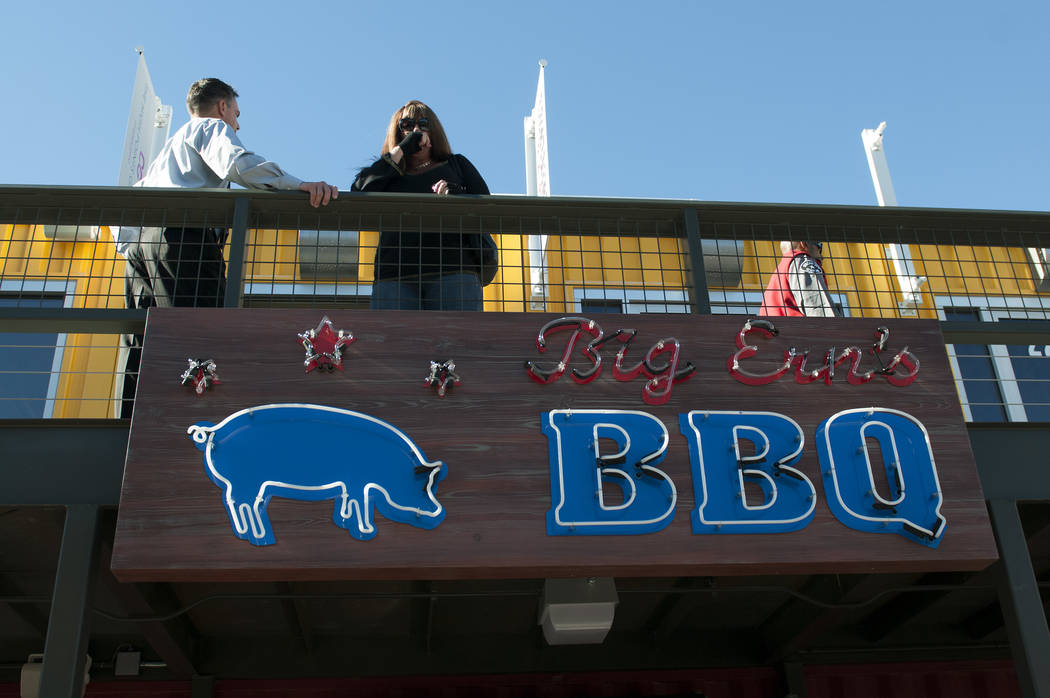 People are seen on the walkway upstairs to Big Ern's BBQ, one of the few eateries opened at the Container Park in downtown Las Vegas during its opening Monday, Nov. 25, 2013. (Erik Verduzco/Las Ve ...