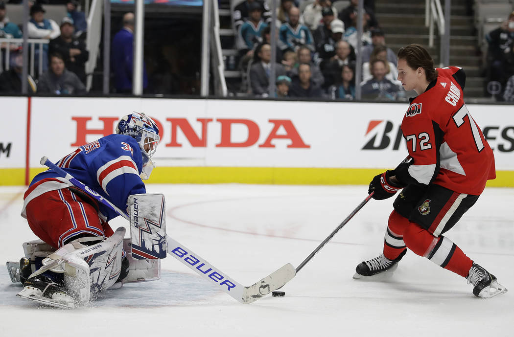 New York Rangers' Henrik Lundqvist, left, defends a shot attempt by Ottawa Senators' Thomas Chabot during the Skills Competition, part of the NHL hockey All-Star weekend, in San Jose, Calif., Frid ...
