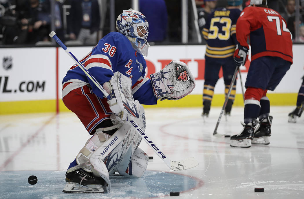 New York Rangers' Henrik Lundqvist (30) warms up before the Skills Competition, part of the NHL All-Star weekend, in San Jose, Calif., Friday, Jan. 25, 2019. (AP Photo/Ben Margot)