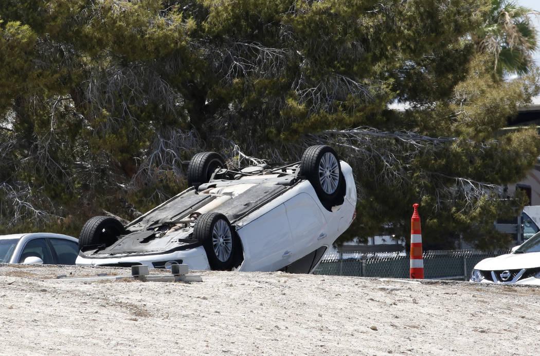 A flipped car involved in a multivehicle crash is seen on Boulder Highway at U.S. Highway 95 on Tuesday, in Las Vegas. Bizuayehu Tesfaye/Las Vegas Review-Journal @bizutesfaye