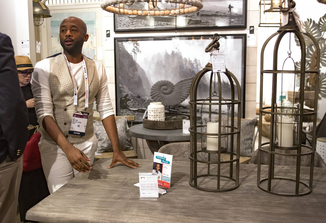 Interior designer Mikel Welch points out an ash gray table at the Mercana showroom on Tour the Trends at the Las Vegas Winter Market at World Market Center in Las Vegas, Sunday, Jan. 27, 2019. Wel ...
