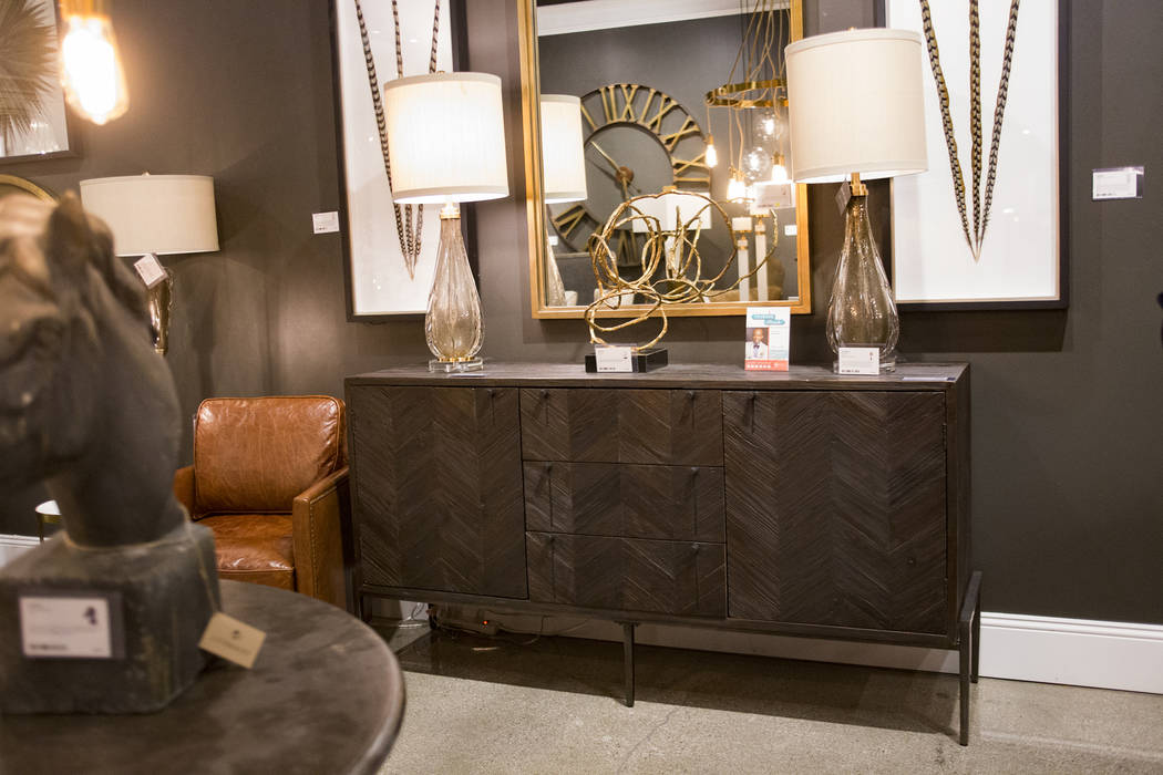 A gray cabinet with a black finish picked by interior designer Mikel Welch for Tour the Trends at the Revelation by Uttermost showroom at the Las Vegas Winter Market at World Market Center in Las ...