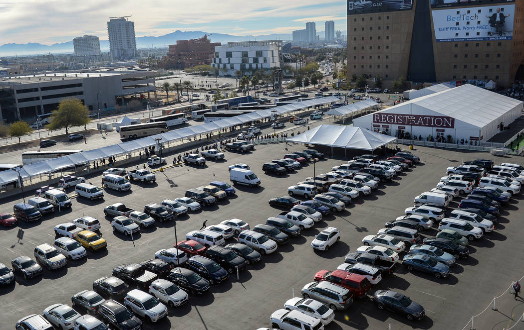 Rows of cars fill surrounding parking lots as crowds of people gather for the opening day of the Las Vegas Winter Market held at the World Market Center in Las Vegas, Sunday, Jan. 27, 2019. Caroli ...