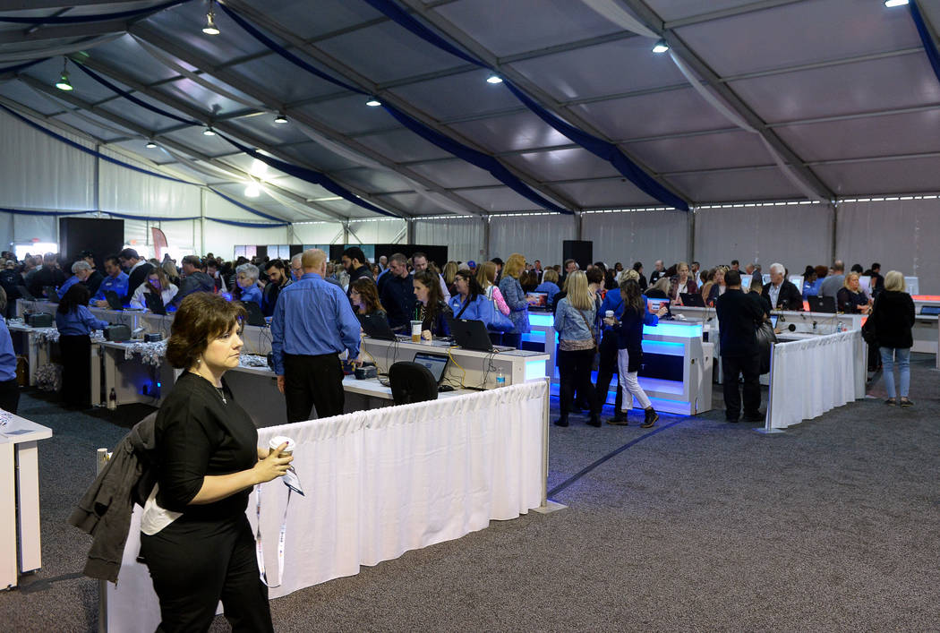 Crowds of people fill the registration tent as gather for the opening day of the Las Vegas Winter Market held at the World Market Center in Las Vegas, Sunday, Jan. 27, 2019. Caroline Brehman/Las V ...