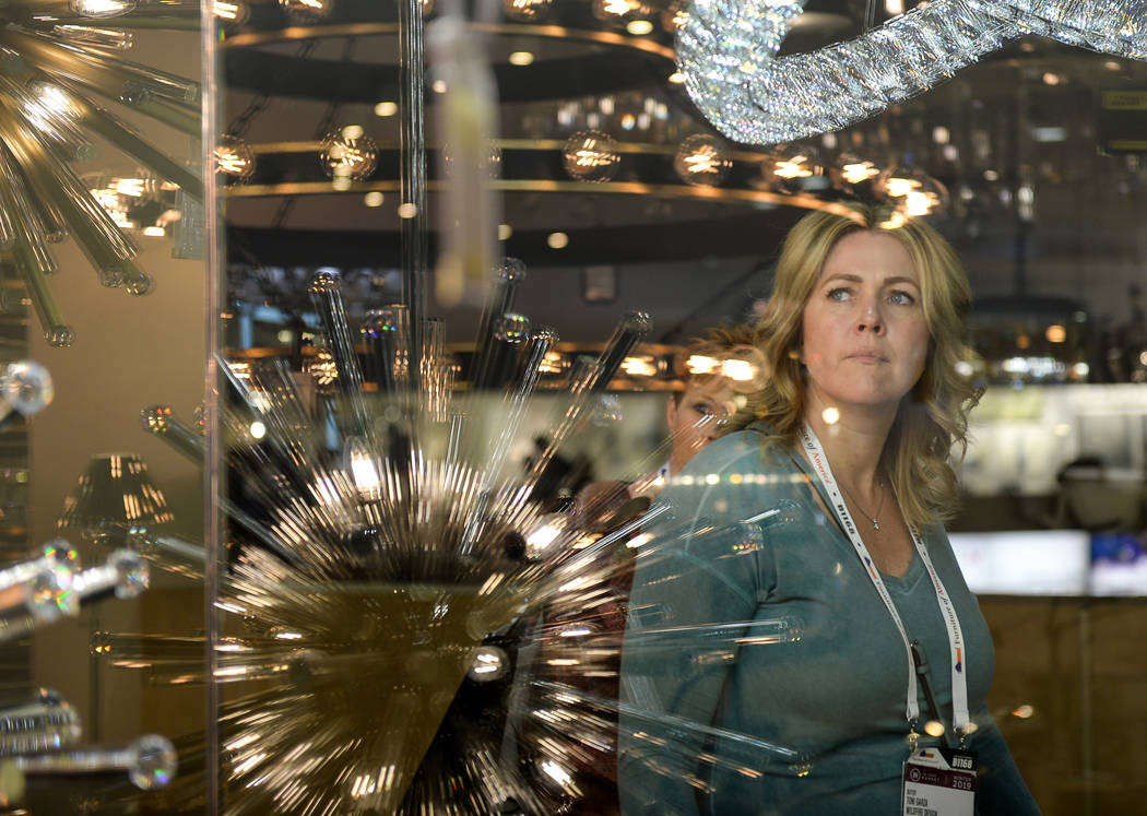 Toni Garza peers in through the Elegant Furniture & Lighting exhibit during the opening day of the Las Vegas Winter Market held at the World Market Center in Las Vegas, Sunday, Jan. 27, 2019. ...