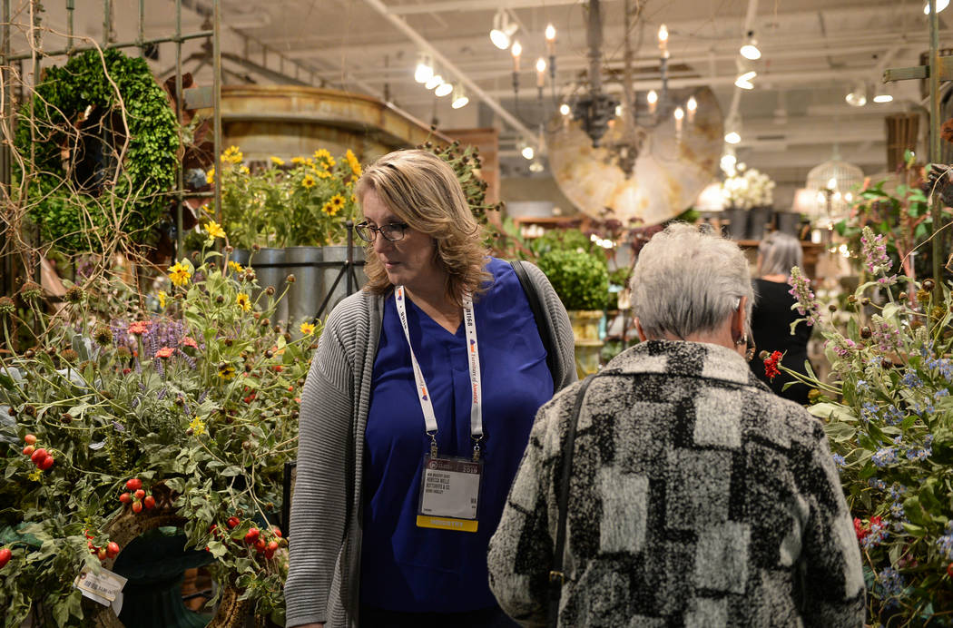 Rebecca Wells walks through the Park Hill exhibit during the opening day of the Las Vegas Winter Market held at the World Market Center in Las Vegas, Sunday, Jan. 27, 2019. Caroline Brehman/Las Ve ...