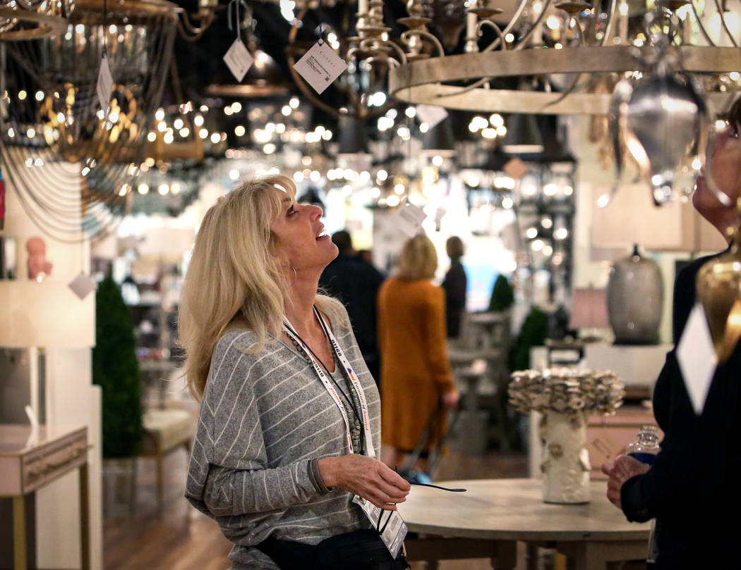 Sharon Hellebrandt looks at the various lighting displays at the Curry exhibit during the opening day of the Las Vegas Winter Market held at the World Market Center in Las Vegas, Sunday, Jan. 27, ...