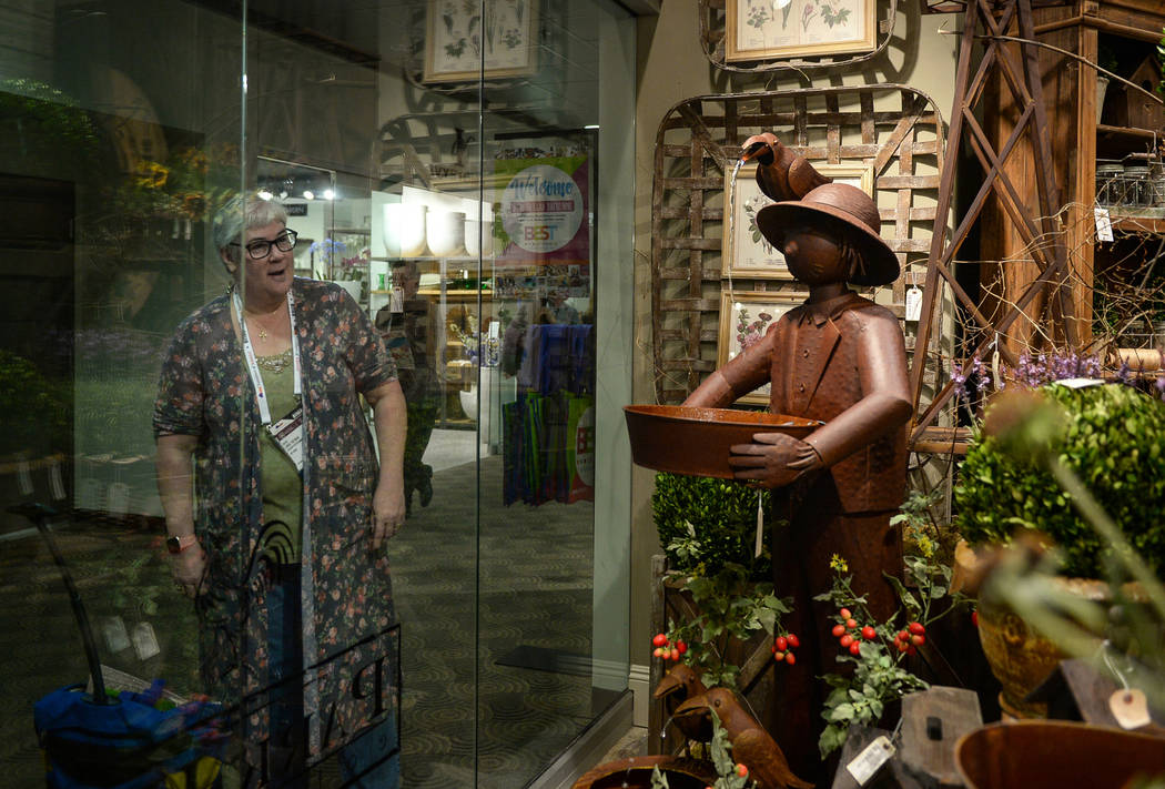 Linda Freeman peers in through the window into the Park Hill exhibit during the opening day of the Las Vegas Winter Market held at the World Market Center in Las Vegas, Sunday, Jan. 27, 2019. Caro ...
