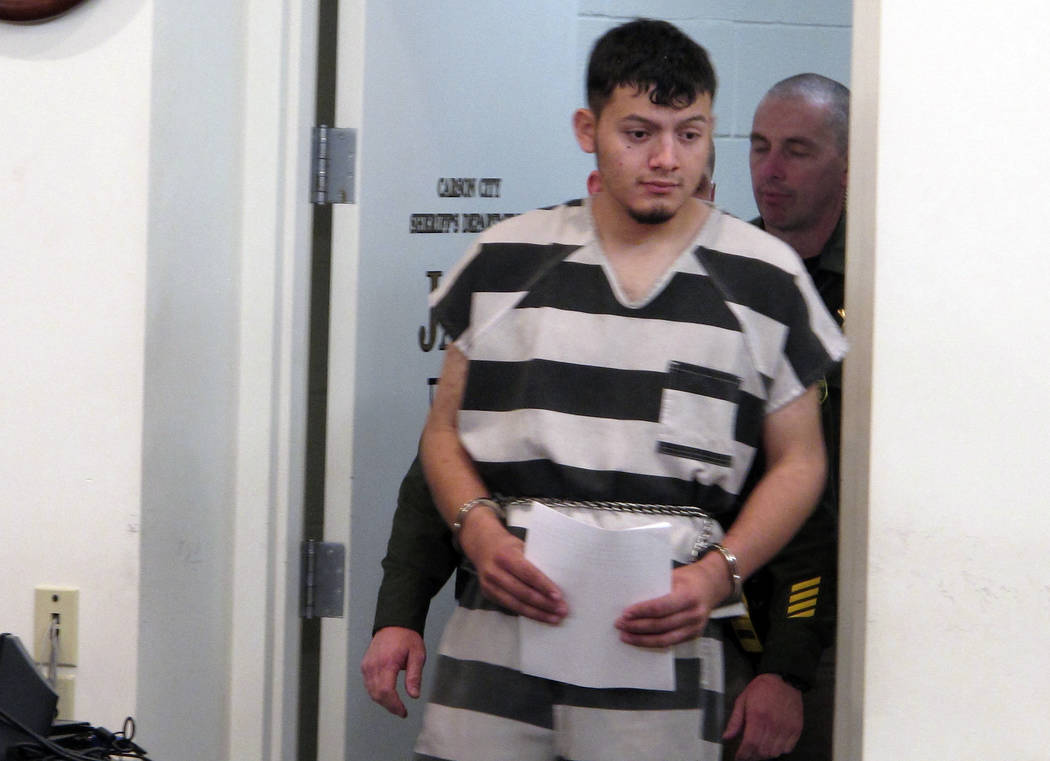 Wilber Ernesto Martinez-Guzman, 19, of El Salvador, is escorted into the courtroom for his initial appearance in Carson City Justice Court, Thursday, Jan. 24, 2019, in Carson City, Nev. Martinez-G ...