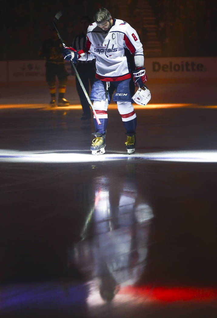 Washington Capitals left wing Alex Ovechkin (8) is reflected in the ice during the national anthem before the start of an NHL hockey game at T-Mobile Arena in Las Vegas on Tuesday, Dec. 4, 2018. C ...