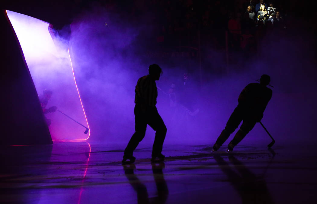 Golden Knights players and referees take the ice before the start of an NHL hockey game against the Washington Capitals at T-Mobile Arena in Las Vegas on Tuesday, Dec. 4, 2018. Chase Stevens Las V ...