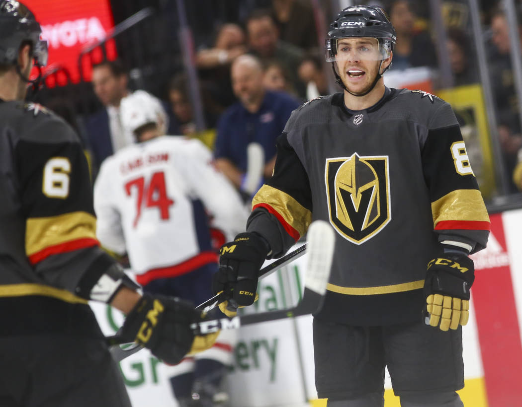 Golden Knights center Jonathan Marchessault talks with teammates during the second period of an NHL hockey game against the Washington Capitals at T-Mobile Arena in Las Vegas on Tuesday, Dec. 4, 2 ...