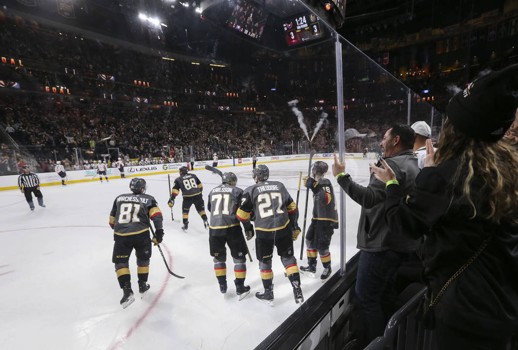 Golden Knights players skate towards the bench after celebrating a goal by Golden Knights defenseman Nate Schmidt (88) during the third period of an NHL hockey game against the Washington Capitals ...