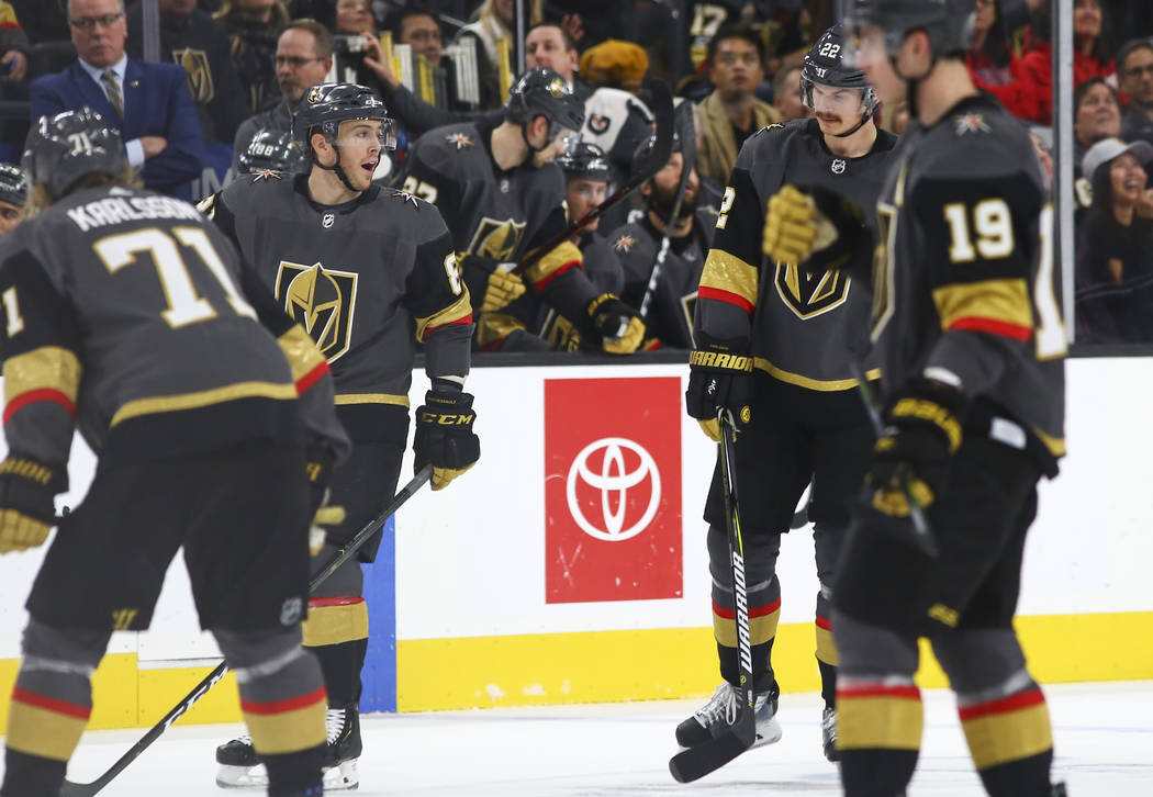Golden Knights center Jonathan Marchessault, left, and Golden Knights defenseman Nick Holden talk during the first period of an NHL hockey game against the Washington Capitals at T-Mobile Arena in ...