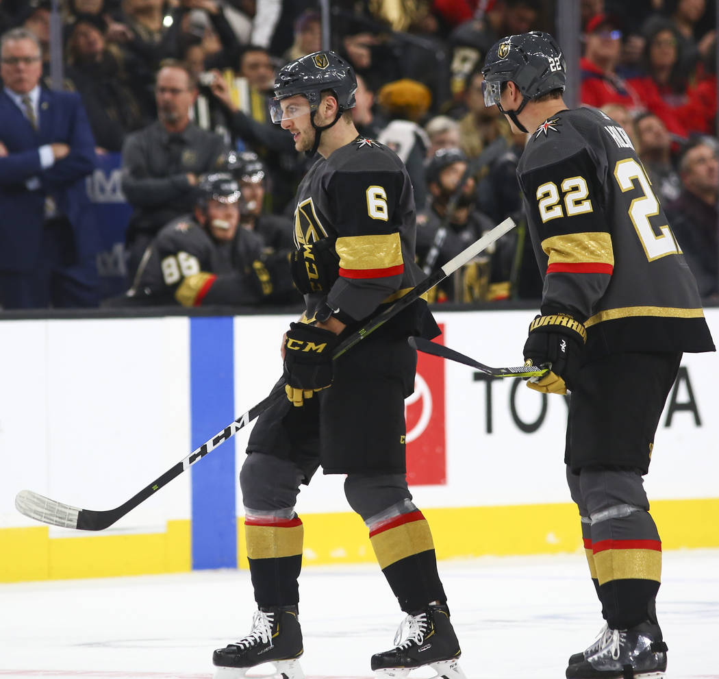 Golden Knights defenseman Colin Miller (6) and Golden Knights defenseman Nick Holden (22) during the first period of an NHL hockey game against the Washington Capitals at T-Mobile Arena in Las Veg ...