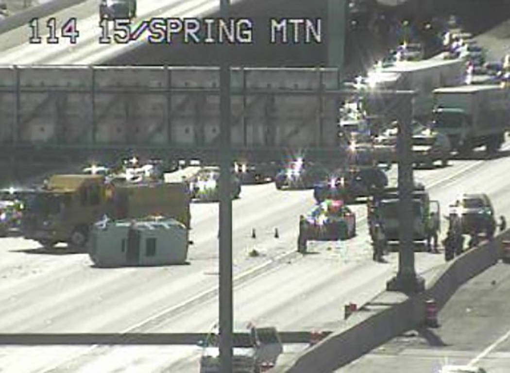 Live traffic cameras show a white SUV rolled on its side, surrounded by first responders. (RTC Traffic Cam)