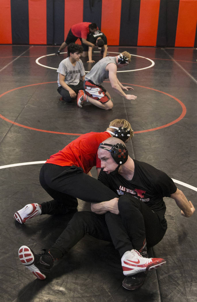 Daniel Law, right/bottom, fights for position with teammate Trace Everett during wrestling practice on Friday, Jan. 25, 2019, at Las Vegas High School, in Las Vegas. (Benjamin Hager/Las Vegas Revi ...
