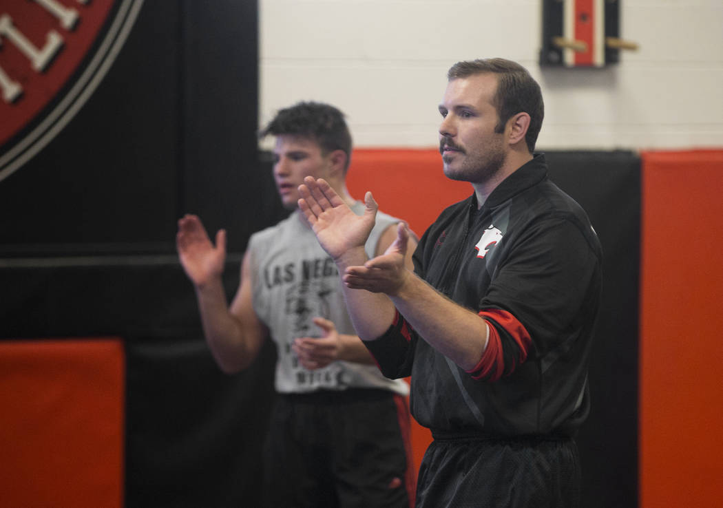 Coach Zach Hocker, right, gives direction during wrestling practice on Friday, Jan. 25, 2019, at Las Vegas High School, in Las Vegas. (Benjamin Hager/Las Vegas Review-Journal) @BenjaminHphoto