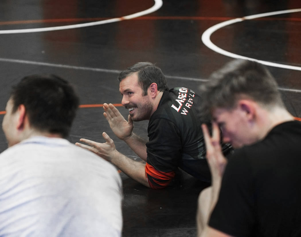 Coach Zach Hocker gives direction during wrestling practice on Friday, Jan. 25, 2019, at Las Vegas High School, in Las Vegas. (Benjamin Hager/Las Vegas Review-Journal) @BenjaminHphoto