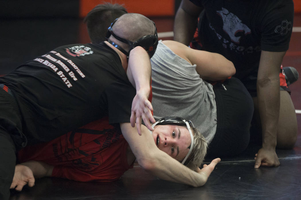Trace Everett, middle, fights for position with teammate Daniel Law during wrestling practice on Friday, Jan. 25, 2019, at Las Vegas High School, in Las Vegas. (Benjamin Hager/Las Vegas Review-Jou ...