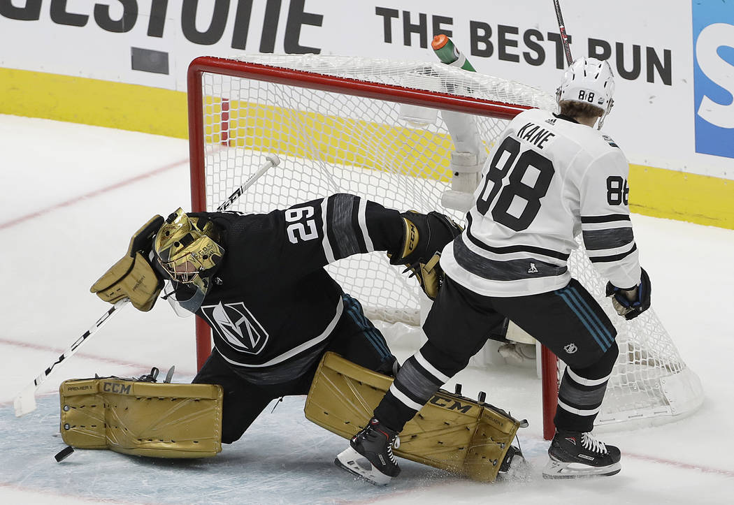 Pacific Division's Marc-Andre Fleury, left, of the Vegas Golden Knights, defends against a shot-attempt by Central Division's Patrick Kane, of the Chicago Blackhawks, during the second half of a s ...