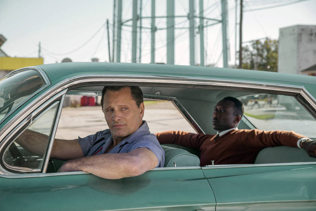 """This image released by Universal Pictures shows Viggo Mortensen, left, and Mahershala Ali in a scene from """"Green Book."""" (Patti Perret/Universal Pictures via AP)"""