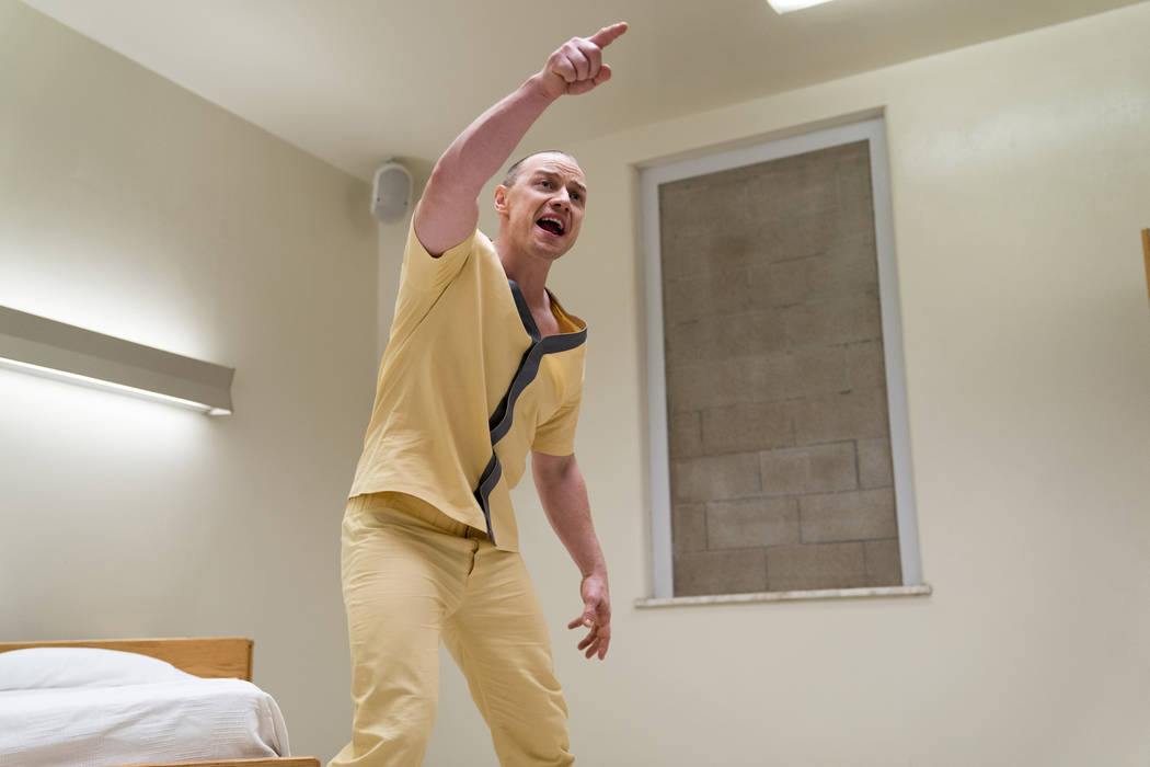 """This image released by Universal Pictures shows James McAvoy in a scene from M. Night Shyamalan's """"Glass."""" (Jessica Kourkounis/Universal Pictures via AP)"""
