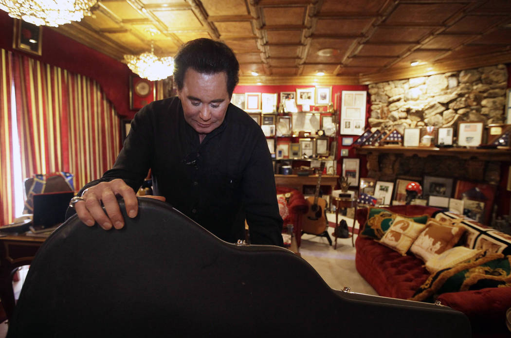 FILE - In this Friday, Nov. 12, 2010, file photo, Wayne Newton shows some of the memorabilia in the Red Room during an interview at his home in Las Vegas. Newton will mark his 60th anniversary wit ...