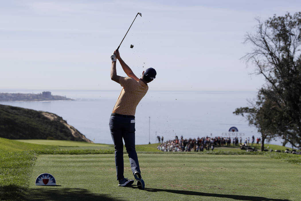 Justin Rose, of England, watches his tee shot on the third hole of the South Course at Torrey Pines Golf Course during the final round of the Farmers Insurance golf tournament Sunday, Jan. 27, 201 ...