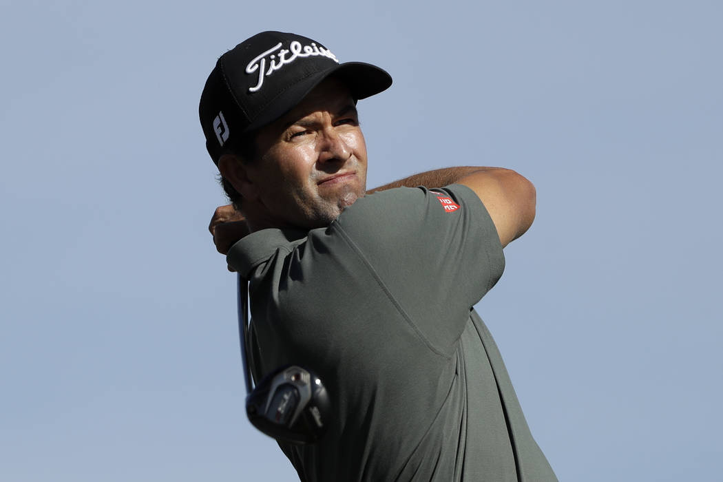 Adam Scott, of Australia, watches his tee shot on the second hole of the South Course at Torrey Pines Golf Course during the final round of the Farmers Insurance golf tournament Sunday, Jan. 27, 2 ...