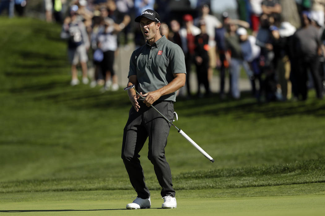 Adam Scott, of Australia, reacts as his putt for birdie just misses on the second hole of the South Course at Torrey Pines Golf Course during the final round of the Farmers Insurance golf tourname ...