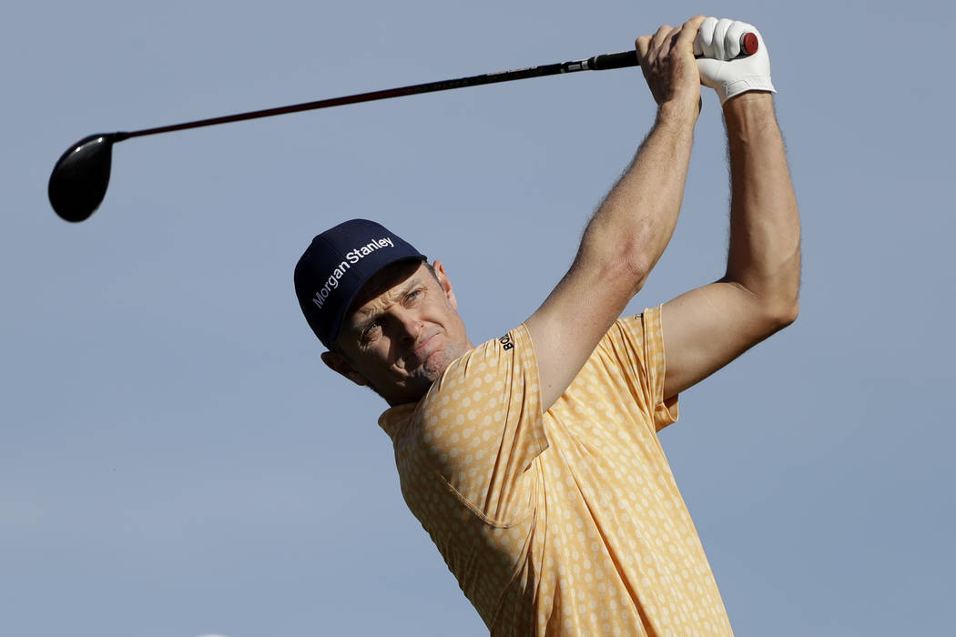 Justin Rose, of England, watches his tee shot on the second hole of the South Course at Torrey Pines Golf Course during the final round of the Farmers Insurance golf tournament Sunday, Jan. 27, 20 ...