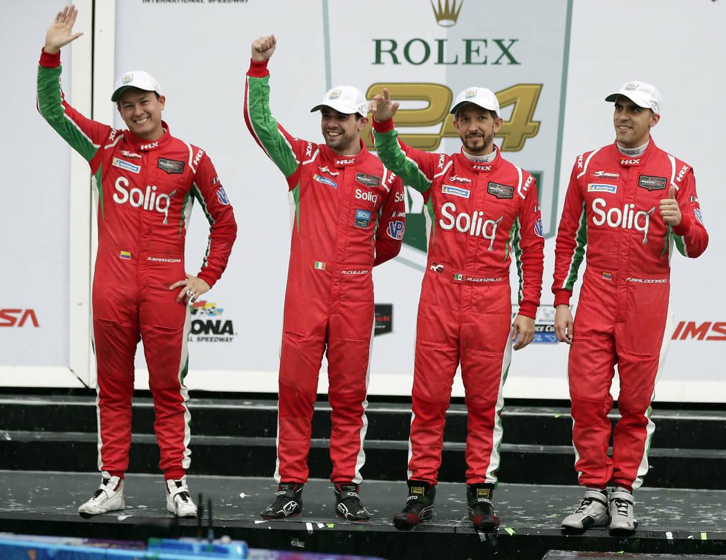 Winners of the Le Mans Prototype 2 class in the IMSA 24 hour race, from left, Sebastian Saavedra, of Colombia, Ryan Cullen, of Ireland, Roberto Gonzalez of Mexico, and Pastor Maldonado, of Venezue ...