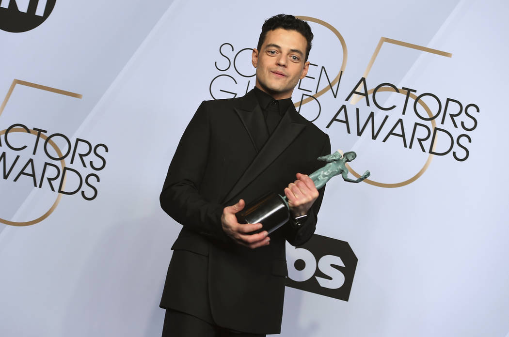"Rami Malek poses with the award for outstanding performance by a male actor in a leading role for ""Bohemian Rhapsody"" in the press room at the 25th annual Screen Actors Guild Awards at t ..."
