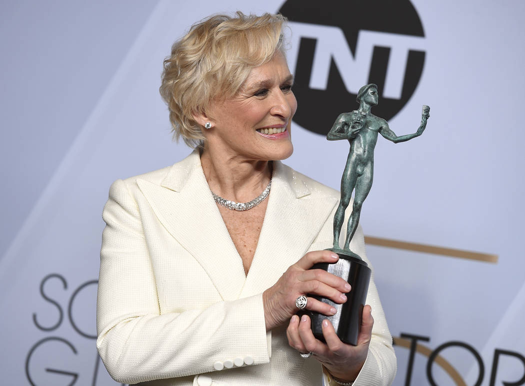 "Glenn Close poses with the award for outstanding performance by a female actor in a leading role for ""The Wife"" in the press room at the 25th annual Screen Actors Guild Awards at the Shr ..."