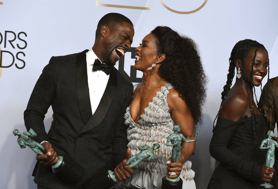 "Sterling K. Brown, left, winner of the awards for outstanding performance by a cast in a motion picture for ""Black Panther"" and the award for outstanding performance by an ensemble in a ..."