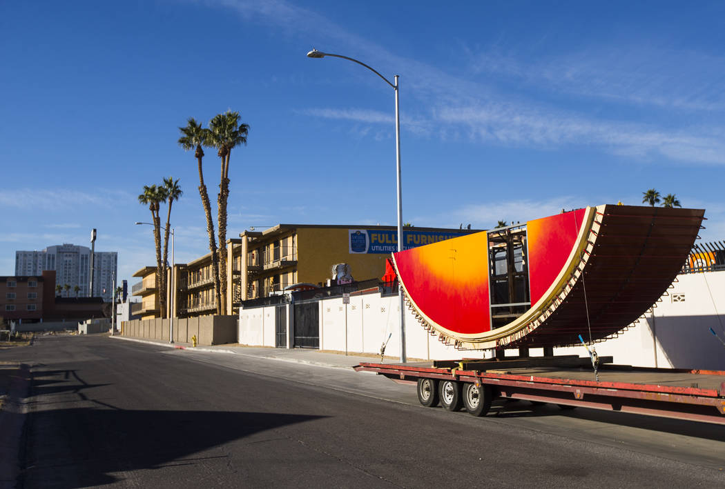 The first piece of the Hard Rock Cafe guitar sign sits outside of the Neon Museum before being installed by YESCO employees in Las Vegas on Monday, Jan. 28, 2019. Chase Stevens Las Vegas Review-Jo ...