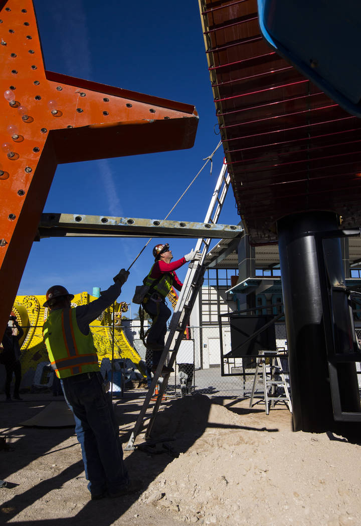 YESCO employees install first piece of the Hard Rock Cafe guitar sign at the Neon Museum in Las Vegas on Monday, Jan. 28, 2019. Chase Stevens Las Vegas Review-Journal @csstevensphoto