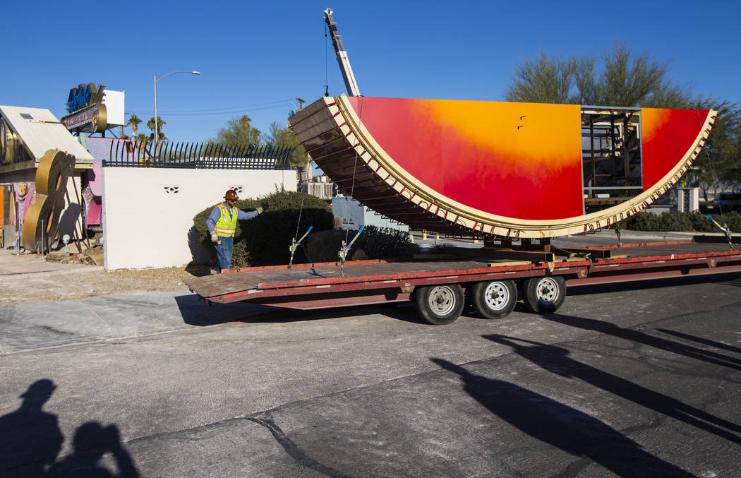 The first piece of the Hard Rock Cafe guitar sign is moved into the Neon Museum before being installed by YESCO employees in Las Vegas on Monday, Jan. 28, 2019. Chase Stevens Las Vegas Review-Jour ...