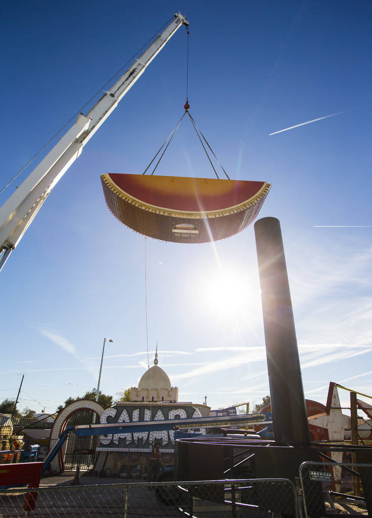 The first piece of the Hard Rock Cafe guitar sign is installed by YESCO employees at the Neon Museum in Las Vegas on Monday, Jan. 28, 2019. Chase Stevens Las Vegas Review-Journal @csstevensphoto