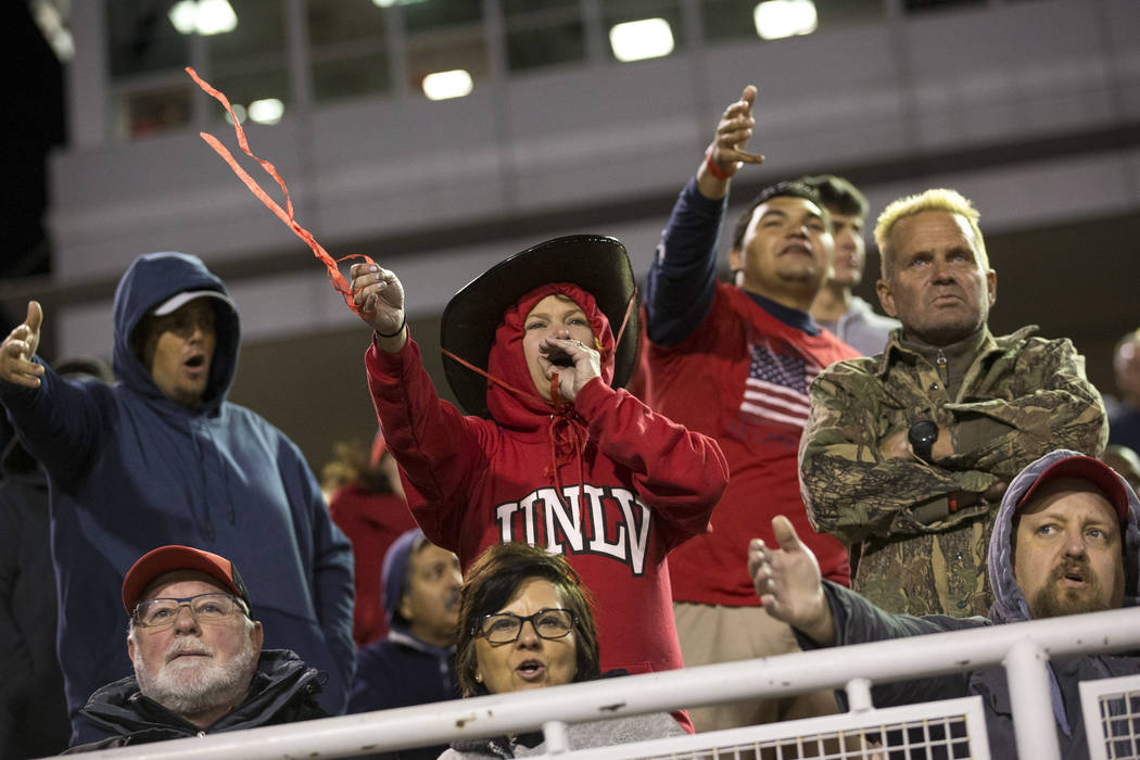 UNLV Rebels fans cheer against the Nevada Wolf Pack during the second half of an NCAA football game at Sam Boyd Stadium in Las Vegas on Saturday, Nov. 24, 2018. Richard Brian Las Vegas Review-Jour ...