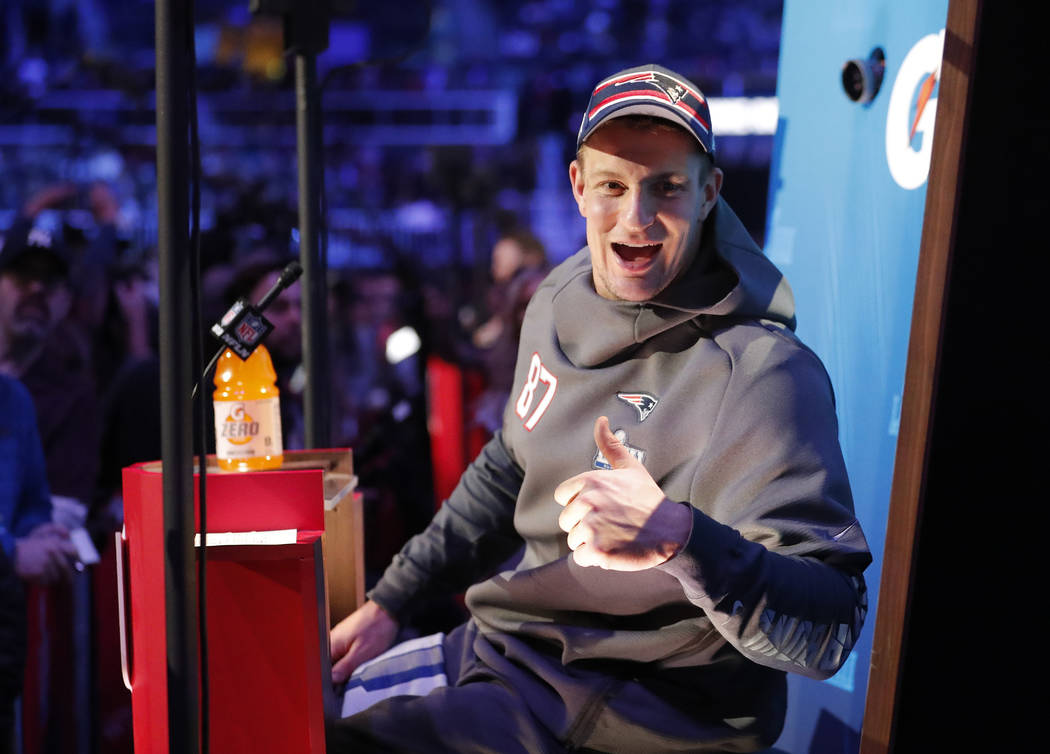New England Patriots' Rob Gronkowski reacts during Opening Night for the NFL Super Bowl 53 football game Monday, Jan. 28, 2019, in Atlanta. (AP Photo/John Bazemore)