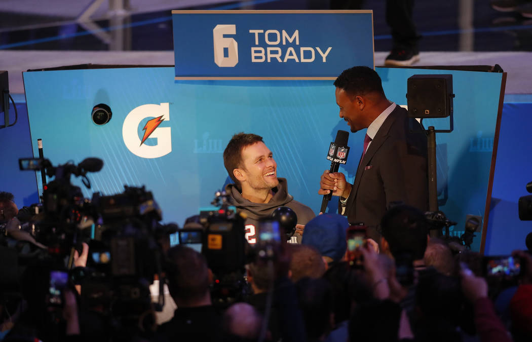 New England Patriots' Tom Brady answers questions during Opening Night for the NFL Super Bowl 53 football game Monday, Jan. 28, 2019, in Atlanta. (AP Photo/John Bazemore)
