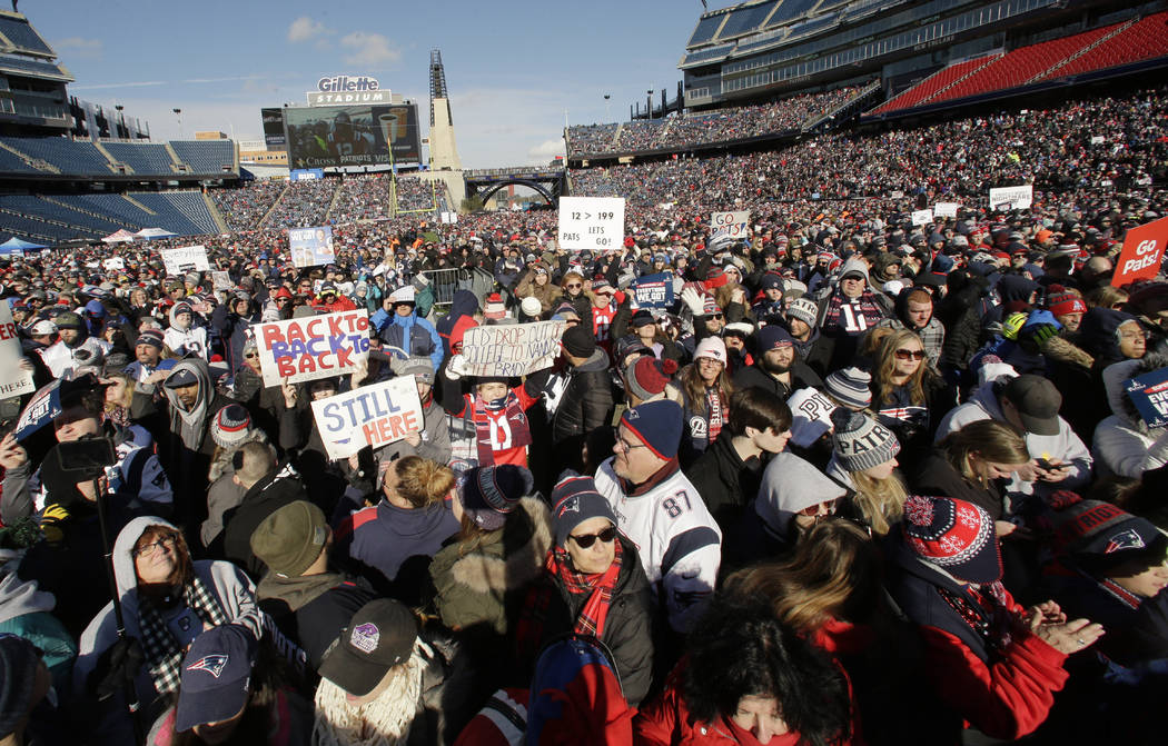 New England Patriots fans hold placards and cheer during an NFL football Super Bowl send-off rally for the team, Sunday, Jan. 27, 2019, in Foxborough, Mass. The Los Angeles Rams are to play the Ne ...